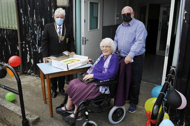 Marion Lowrie, the village's oldest resident, cut the cake to mark the official opening of California Community Hub last month, watched by Provost William Buchanan and Tom Greig, chairman of California Community Hub.b.