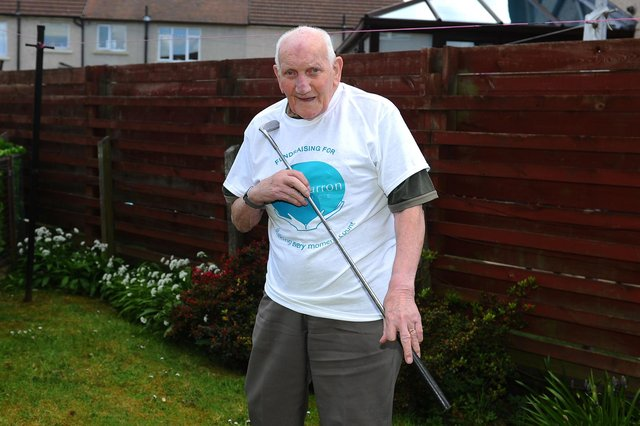 Grangemouth resident Donald Walls, 92, was inspired by the efforts of Captain Tom as he holed 100 putts for Strathcarron Hospice. Picture: Michael Gillen.