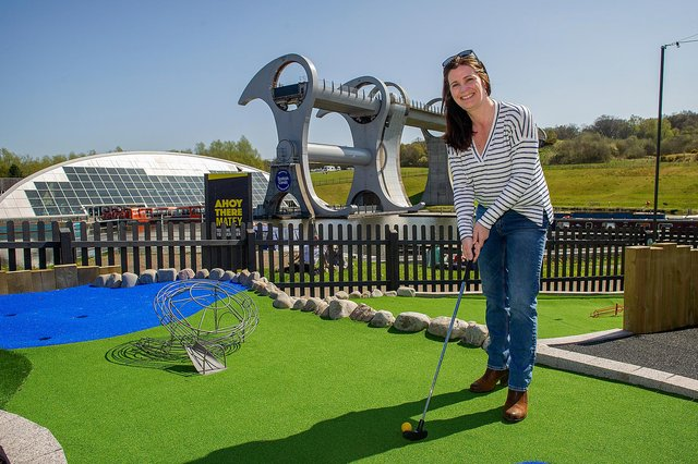 Catherine Topley, CEO at Scottish Canals, tries  out the new crazy golf attraction at The Falkirk Wheel.