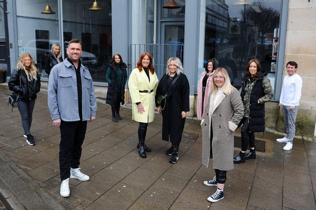 Tweedie and Marshall staff, including stylist Justine Weir (fifth from right), celebrated their 10th anniversary on March 14. Owners Anthony Tweedie and Connie Marshall (front). Picture: Michael Gillen.