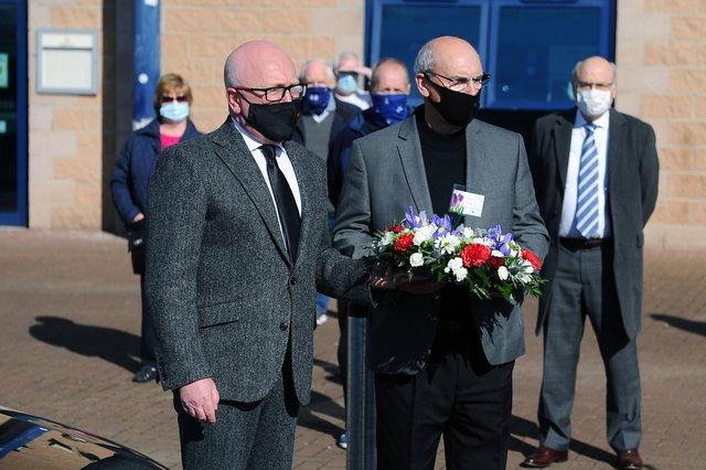 Paying tribute: Alex Totten and Falkirk club chairman, Gary Deans wait to lay a wreath in memory of well known goalkeeper Willie Whigham who died at the age of 81 (Pic: Michael Gillen)