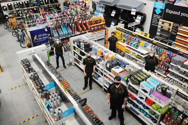 Halfords in Falkirk's Central Retail Park reopened on March 25 after an electrical fire forced it to close for eight months. Manager Greg Dornan (top left) with colleagues.Picture: Michael Gillen.
