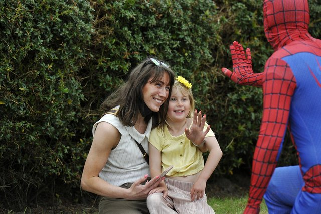 Spider Man swings in for a guest appearance at the opening of the new California Community Hub