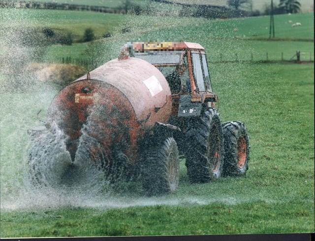 Field sprayed with sewage sludge