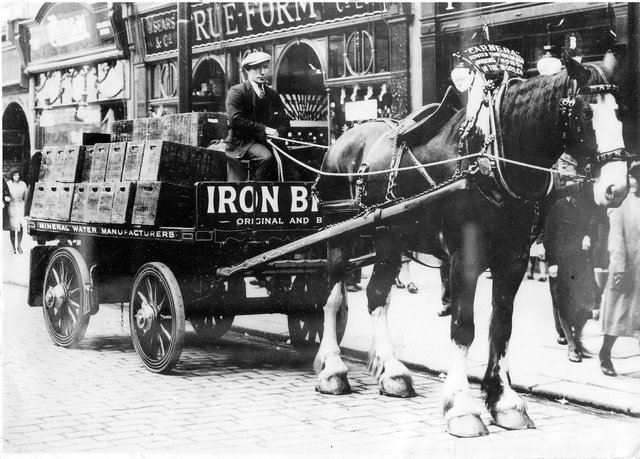 The mighty Clydesdale horse Carnera hard at work in Falkirk town centre back in the day