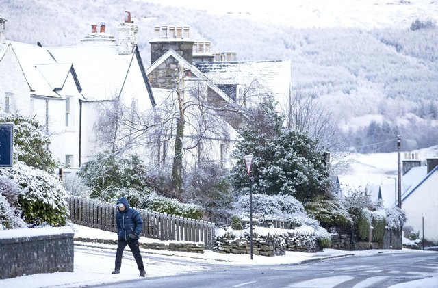 A man walks through the snow in Killin, Stirlingshire