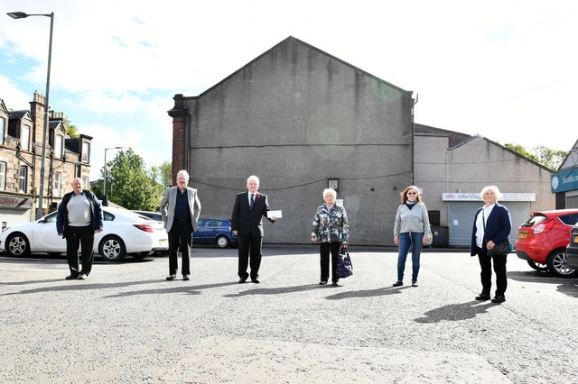 Provost Billy Buchanan and Greenhill Historical Society members began a fundraising campaign to pay for a new Bonnybridge mural on the gable end of the village's Co-op store in 2020. Picture: Michael Gillen.