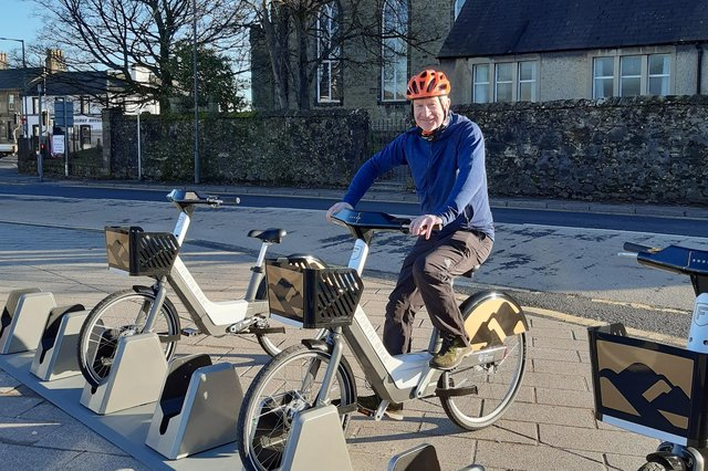 Councillor Paul Garner, Falkirk council spokesperson for the environment at the new electric bike hire station in Denny,