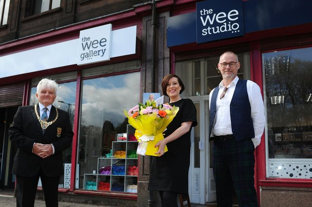 Provost William Buchanan;Lauren Campbell, owner ofThe Wee Gallery and The Wee Studio andChristo Craig, manager.