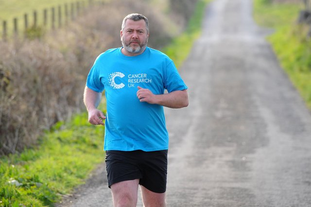 Dunipace resident Alan Purcell is tackling a 100km charity hill run in April in aid of Cancer Research in memory of his mum and two friends. Picture: Michael Gillen.