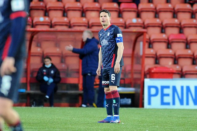 Falkirk captain Gary Miller looks devastated at the end of the game