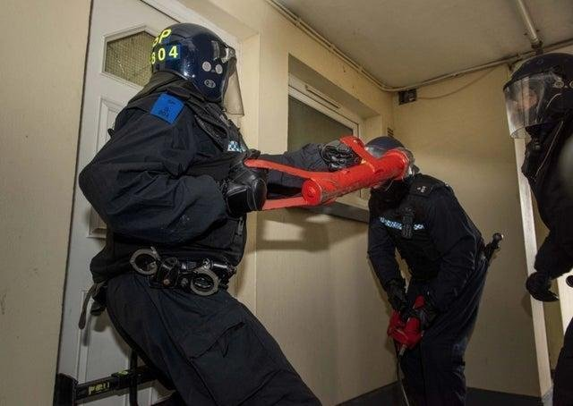 Police carrying out a raid in 2020 during Operation Venetic - the biggest ever UK operation into serious and organised crime involving Police Scotland, the National Crime Agency (NCA) and police forces across the country.