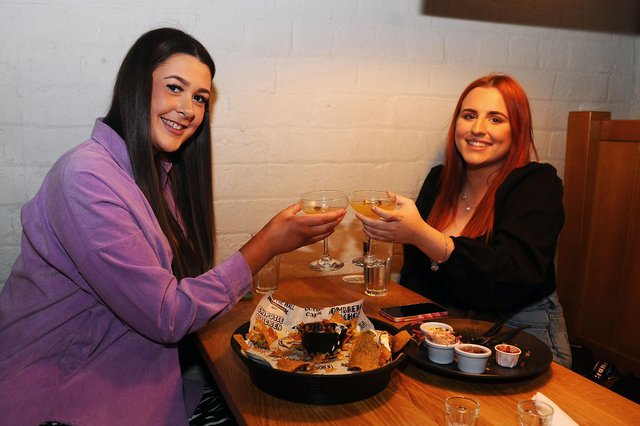 DAy 1 in Level 2, and Behind The Wall was a busy place - Nina Johnston 19, Larbert and Stephanie Lusk 19, Bonnybridge, enjoy their meal (Pic: Michael Gillen)